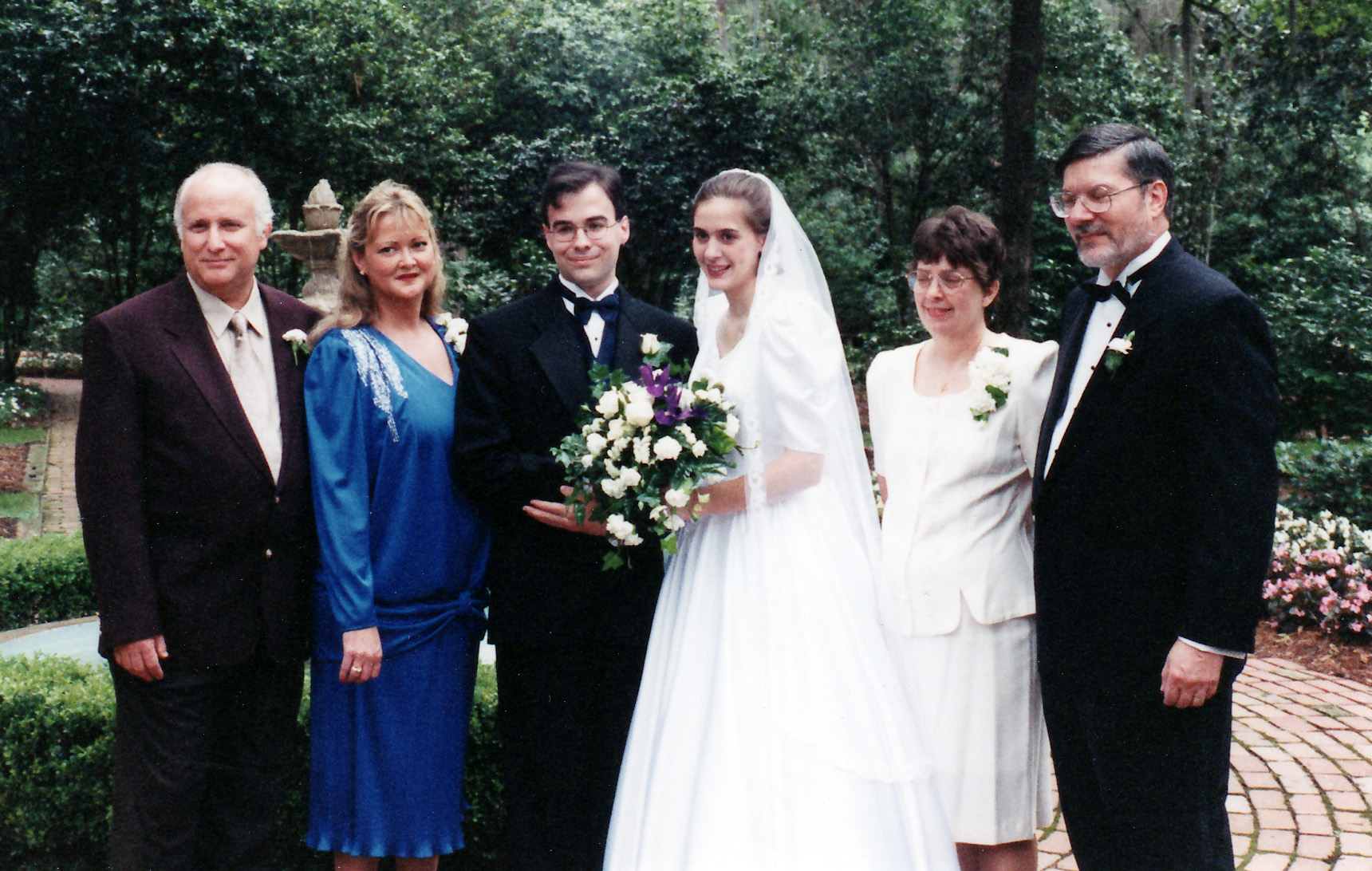Photo of Toby and Christy's wedding, along with parents.
