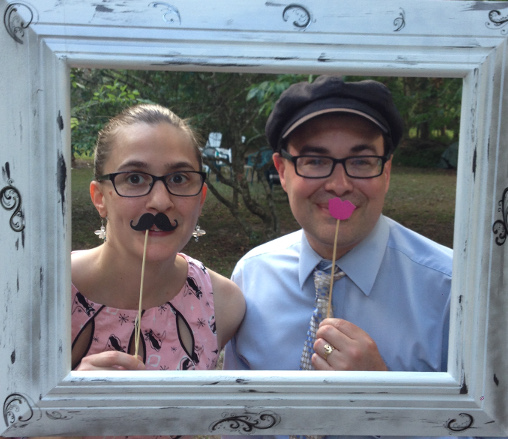 Christy with mustache and Toby with pink lips in a painted frame