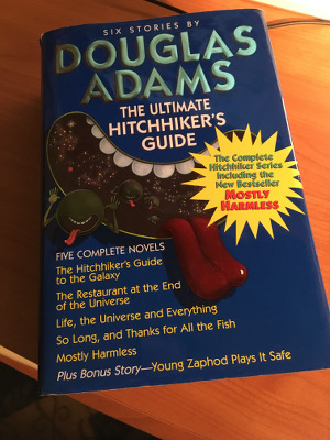 "Photograph of book titles ""The Ultimate Hitchhiker's Guide: six stories by Douglas Adams"""