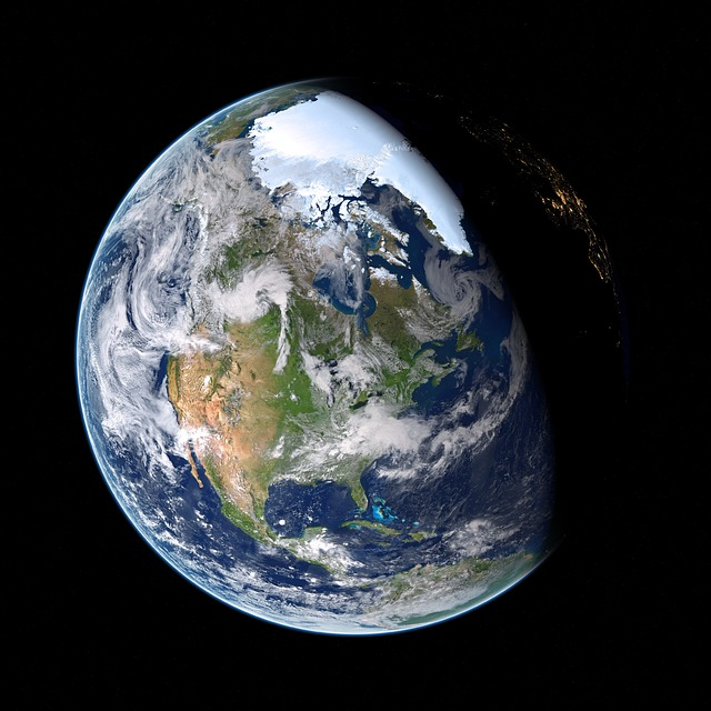 Photo of Earth from space, with part of the planet in daylight, and part in nighttime