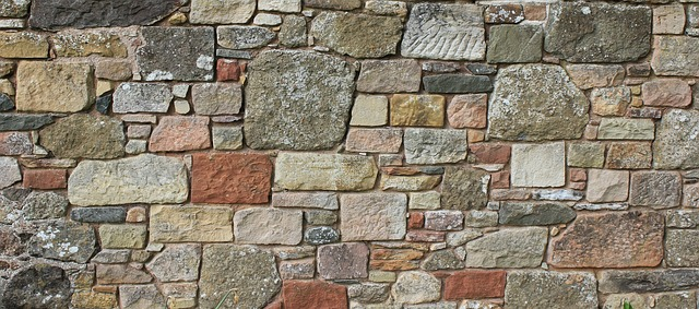 photo of a wall made with stones of various shapes and natural colors